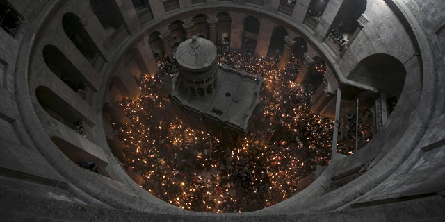 File photo - Worshippers hold candles as they take part in the Christian Orthodox Holy Fire ceremony at the Church of the Holy Sepulchre in Jerusalem's Old City April 11, 2015. (REUTERS/Baz Ratner)