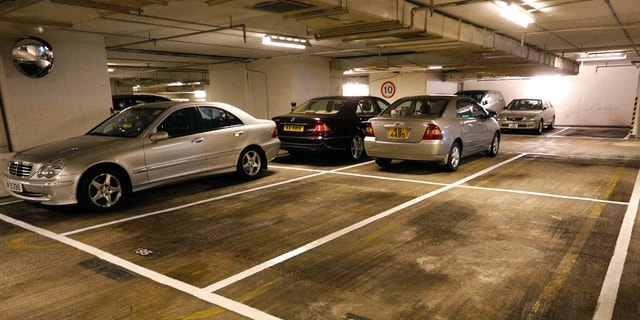 Cars are parked near empty spots at a residential building in Hong Kong Tuesday, Nov. 27, 2012.