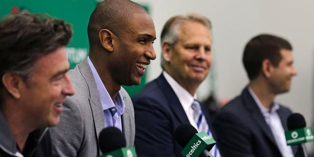 Going from Celtics green to Lakers purple and gold could be in Horford's future. (AP Photo/Charles Krupa)