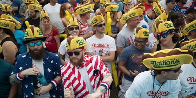 The July 4th event attracts thousands of spectators at New York's Coney Island boardwalk.