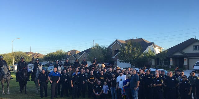 Kevin Will, Jr., whose policeman father was killed in an on-duty crash months before he was born, was escorted to kindergarten by his father's fellow officers of the Houston Police Department.