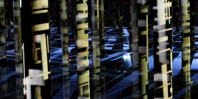 """In this Friday, Dec. 16, 2016, photo, the exhibition of an abstract-video installation called """"Rain"""" by Venezuelan artist Magdalena Fernández is projected inside a former water reservoir dubbed the """"Cistern"""" in Houston. Once eyed for demolition, the former water reservoir built in 1926 has now found new life as a public space that's also serving as an unusual canvas for art. The reservoir's rebirth is the latest example of efforts by cities around the country to reuse and repurpose abandoned and dilapidated pieces of infrastructure as public spaces. (AP Photo/David J. Phillip)"""