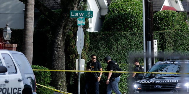 Police investigate the scene of a shooting in Houston on Sept. 26.
