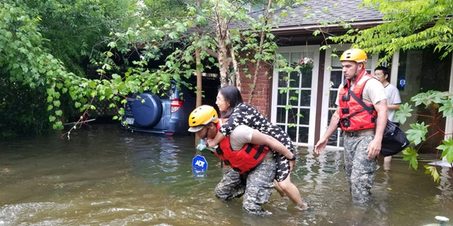 Texas National Guard soldiers aid stranded residents in heavily flooded areas of Houston, Texas, Aug. 27, 2017.