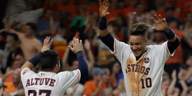 Yuli Gurriel and Jose Altuve celebrate during the Houston Astros win over the New York Yankees in Game 7 of the 2017 American League Championship Series.