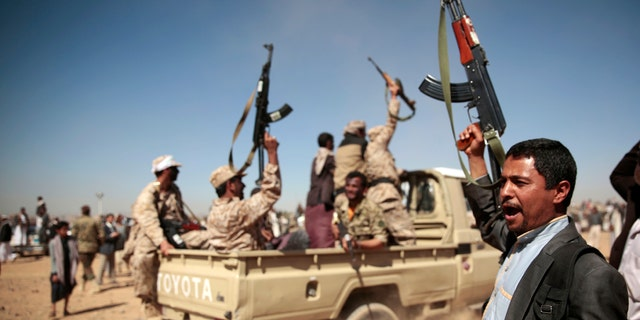 A tribesman loyal to the Houthi rebels, right, chants slogans during a gathering aimed at mobilizing more fighters into battlefronts to fight pro-government forces in several Yemeni cities, in Sanaa, Yemen.