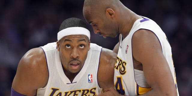 Jan. 13, 2013: Los Angeles Lakers guard Kobe Bryant, right, chats with center Dwight Howard during the first half of the Lakers' NBA basketball game against the Cleveland Cavaliers in Los Angeles.