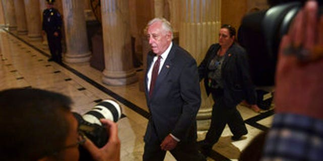 House Minority Whip Steny Hoyer, D-Md., walks past reporters on Capitol Hill in Washington, Thursday, Nov. 16, 2017.