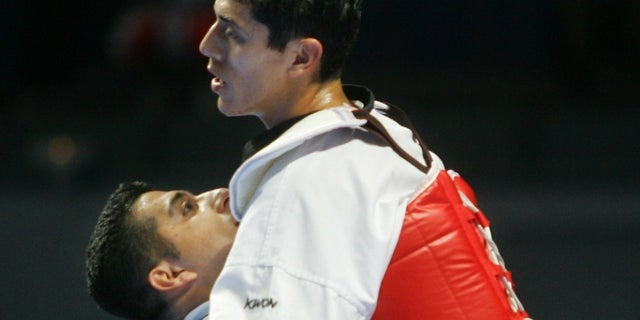 Jean Lopez, left, and Steven Lopez are now prominent coaches in the taekwondo industry.