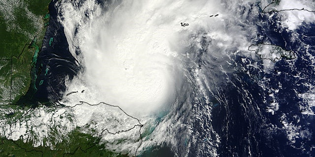 Oct. 24, 2011: Hurricane Rina as seen by the MODIS instrument on NASA's Terra satellite on when it was off the coast of Mexico. Rina's southwestern edge was over Honduras at this time.