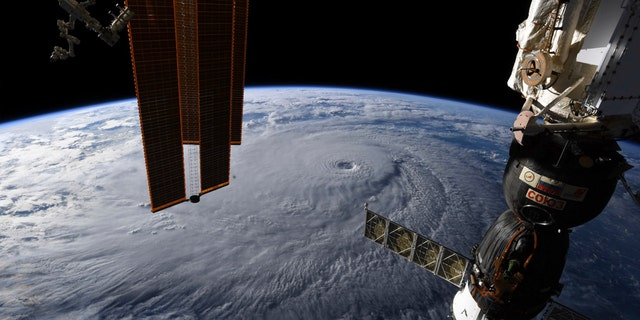 This image provided by NASA on Wednesday, Aug. 22, 2018 shows Hurricane Lane as seen from the International Space Station.