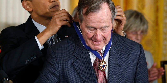Former President George H.W. Bush is awarded the Medal of Freedom by then-President Barack Obama.