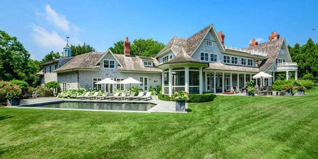 The 9,000 square foot home boasts seven bedrooms and seven full baths.