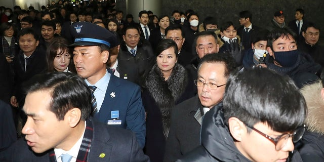 North Korean Hyon Song Wol, center, head of North Korea's art troupe, arrives at the Seoul Train Station in Seoul, South Korea, Sunday, Jan. 21, 2018.