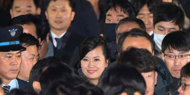 North Korean Hyon Song Wol, center, head of North Korea's art troupe, arrives and smiles at the Seoul Train Station in Seoul, South Korea, Jan. 21, 2018.