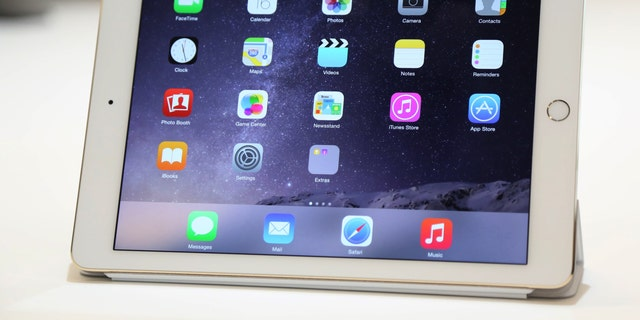 File photo - a new iPad is seen following a presentation at Apple headquarters in Cupertino, California Oct. 16, 2014.