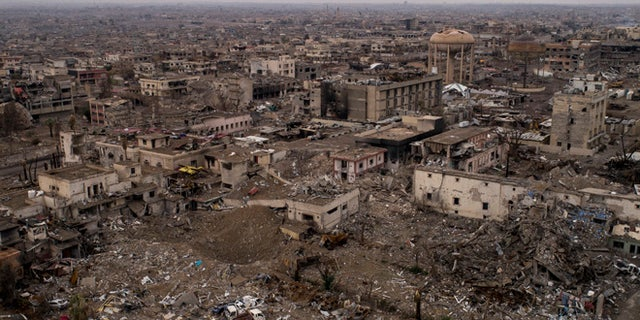 In this Nov. 9, 2017 photo, aerial view of the damaged hospital complex and surrounding areas in Mosul, Iraq. The complex, located in Mosul's al-Shifaa neighborhood, was the main medical center for the Islamic State group during its rule and was heavily damaged during fighting when Iraqi forces wrested Mosul back from the militants.