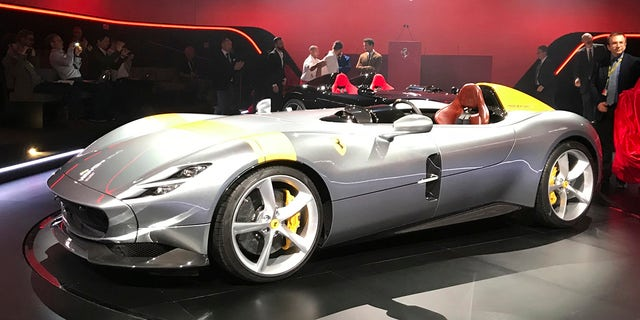 "The Ferrari Monza SP1 is displayed in Maranello, Italy, Tuesday, Sept. 18, 2018. Sportscar maker Ferrari has unveiled two updated versions of its classic open-top ""barchetta"" racing model as it briefs investors on a new five-year business plan. Nicolo Boari, the head of product marketing, said Tuesday that the Ferrari Monza SP1 and SP2 are ""the most powerful ever in Ferrari history,"" with an 810 horsepower engine able to reach 100 kilometers per hour (62 mph) in 2.9 seconds. (AP Photo/Collen Barry)"