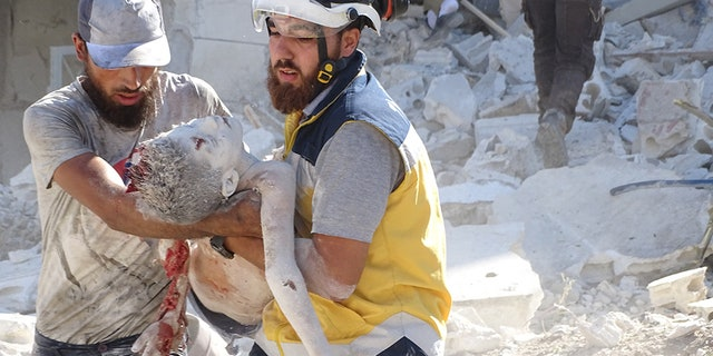 the White Helmets, also known as the Syrian Civil Defense, rescue victims form the rubble as pro-Assad forces resume airstrikes in the region