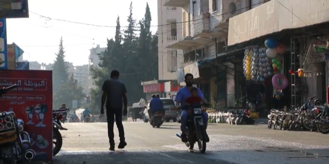 People of Idlib, Syria try to live their normal lives despite a pending offensive.