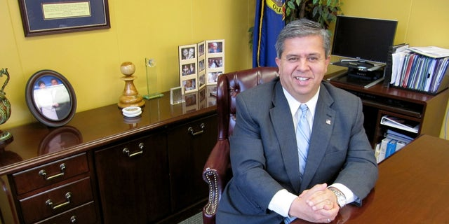 Feb. 9, 2010: FILE - In this file photo, Idaho Superintendent of Public Instruction Tom Luna poses for a photo at his office in Boise, Idaho. Parents across Idaho will now play a role in whether or not their childs teacher gets a raise.