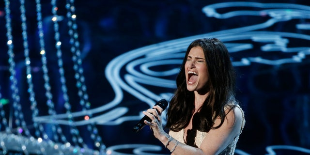"March 2, 2014. Idina Menzel performs nominated original song ""Let it Go"" by Robert Lopez and Kristen Anderson-Lopez, for the film ""Frozen"" at the 86th Academy Awards in Hollywood, California."