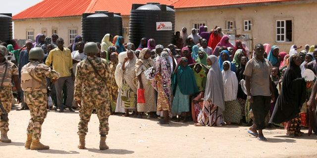 August 29, 2016: Security personnel are seen at the Bakkasi camp for Internally Displaced People (IDP), after security was called in to control a protest rally over shortages of food, medicine and clothing in the refugee camp.