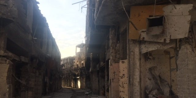 """Little remains of Mosul's """"Old City,"""" prompting many displaced persons to return to camps to survive"""