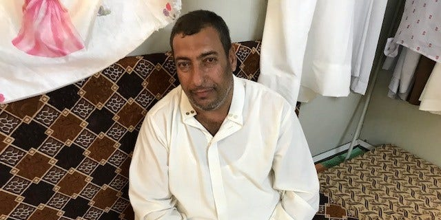 Khatar Khalaf Rashid, a father from Iraq's Salahuddin who returned to a camp after being targeted by local sectarian gangs