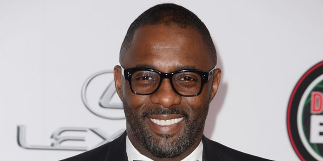 Idris Elba is denying theories that celebrities are paid to say they have coronavirus.