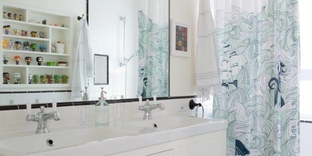 A bathroom by Karen Vidal with an IKEA sink top.