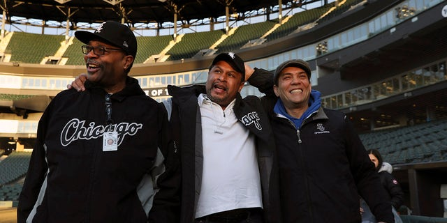 Chicago White Sox groundskeeper Nevest Coleman, center, laughs with friend and fellow grounds crew Harry Smith Jr., left, and friend and now supervisor Jerry Powe.