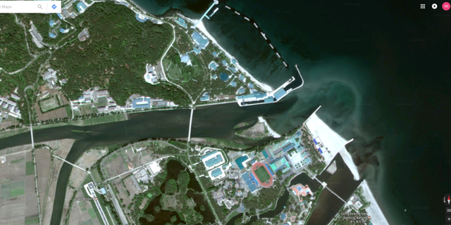 A wider shot of Kim's estate shows a private bridge linking to another part of the island which has a railway, an air strip and a sports stadium.