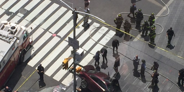 A car plowed into a crowd in Times Square on Thursday.