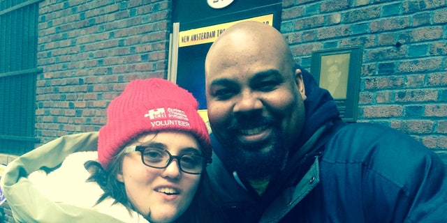 "Albers at the ""Aladdin"" stage door with James Monroe Iglehart, who plays the Genie."