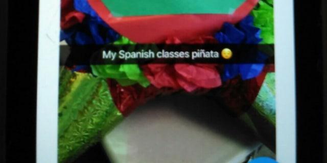 Photos of the piñata spread on social media.