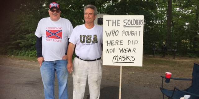 James Bibb (left) and Patrick Werner (right) on hand in Gettysburg, Pa. the men were there following rumors an alt-left group would be in attendance and try to burn the Confederate flag.