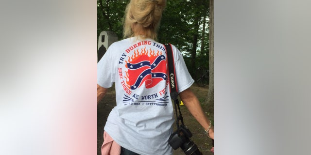 """Pat Roller of Maryland proudly displays her t-shirt that reads """"Try burning this. Some things are worth fighting for."""""""