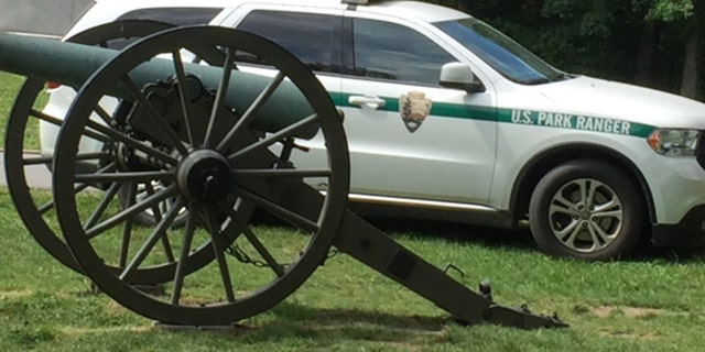 A Civil War canon sits in front of a U.S. Park Ranger vehicle. Security at Gettysburg was ramped up this year after rumors anti-fascist group Antifa would be in attendance.