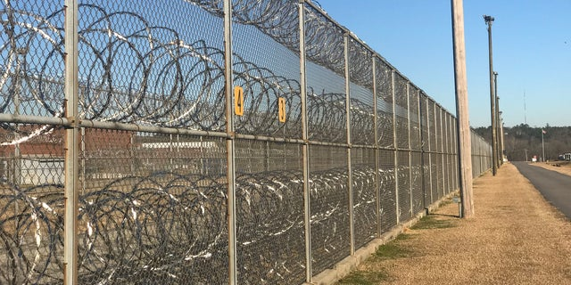 Inmates use cell phones to coordinate deliveries of cell phones and drugs. Some people throw contraband in bags over fences like these or use drones to deliver illegal items. Columbia, SC.