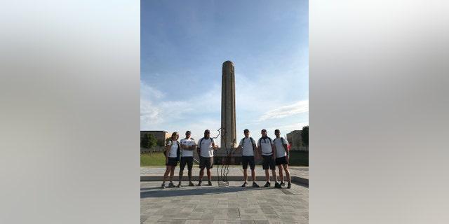 The six veterans at the World War II memorial in Kansas City.
