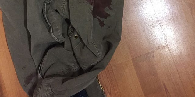 The bloodied jacket worn by Mark Kindschuh, 19, a Boston College student who helped save a man's life during the London terrorist attack.