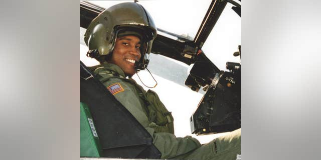 John James, seen here in a helicopter while serving in Iraq.