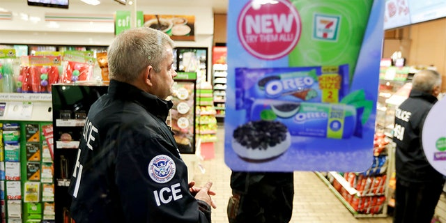 U.S. Immigration and Customs Enforcement agents serve an employment audit notice at a 7-Eleven convenience store Wednesday, Jan. 10, 2018, in Los Angeles, Calif.