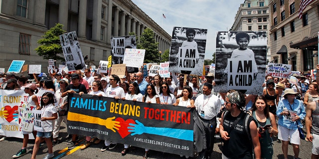 Activists march to protest the Trump administration's approach to illegal border crossings and separation of children from immigrant parents on Saturday in Washington.