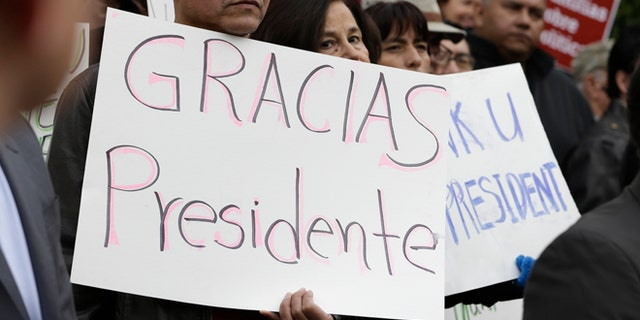 This Friday, Nov. 21, 2014 file photo shows activists and supporters celebrate President Barack Obama's executive action on immigration in Sacramento, Calif.