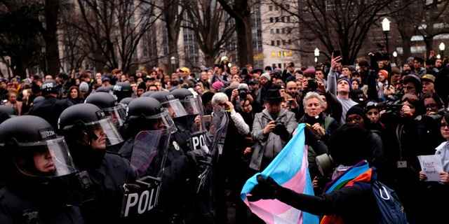 Protesters confront riot police on K Street Northwest outside the offices of The Washington Post as they react to the swearing in of U.S. President Donald Trump in Washington, U.S., January 20, 2017. REUTERS/James Lawler Duggan - RTSWLYJ