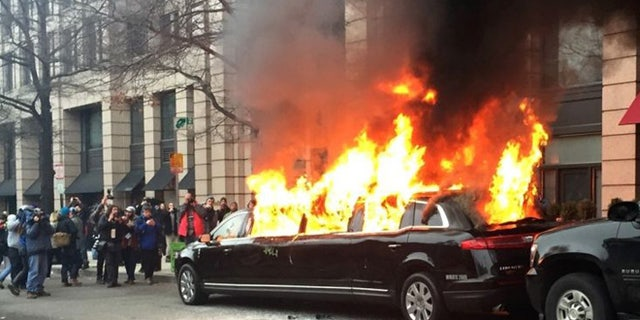 Protesters set a parked limousine on fire in downtown Washington, Friday, Jan. 20, 2017, during the inauguration of President Donald Trump.