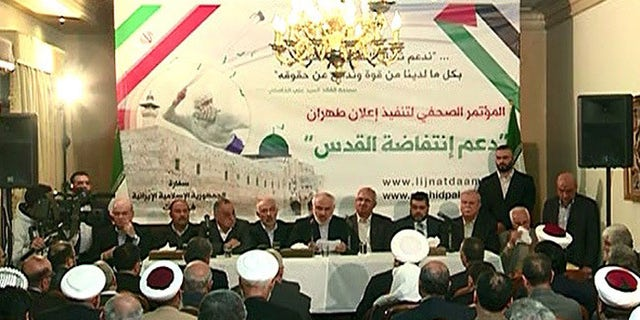 Iranian Ambassador to Lebanon Mohammad Fatahali, (center), makes announcement at press conference in Beirut.