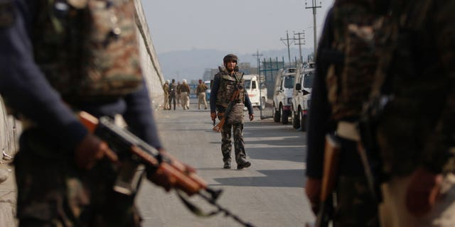 Indian troops patrol outside the Pathankot Air Force Base.